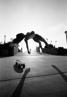 Fast and furious: California's first rollergirls and skateboarders • how to levitate: Take up #Skateboarding :D • as a photographer myself, whoever took this is a freaking genius, bless them