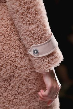 A sumptuous bed of ruffles - romantic nude blush textured jacket; closeup fashion details // Viktor & Rolf