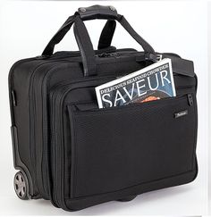 """Pathfinder Revolution Plus 18"""" Checkpoint Wheeled Brief perfect for business travel. It has plenty of room for your laptop, files and other digital devices. It has an easy access key fob, rear sleeve attaches to any rolling upright handle for effortless travel, leather accents for style and durability. Find more travel luggage at http://pathfinderluggage.com/"""