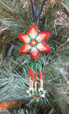 4 Christmas Ornaments Shooting Stars Hand Beaded Fair Trade Red Green & Gold New Nicely beaded on both sides, these shooting star ornaments are well made and are sure to be a nice addition to anyone's Christmas collection.  Great gift idea! $25.95 for a matching set of 4 ornaments w/ free shipping #Christmas #beadwork #ornaments