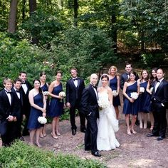 Gallery - In Bliss Weddings The groomsmen wore matching black and white tuxedos. The bridesmaids wore navy blue one shoulder sheath dresses. Their hair and make up were done by Topper's Salon.  - See more at: http://inblissweddings.com/gallery/image/8644/7?_id=233=image_popup=component#sthash.WmfKDMo3.dpuf