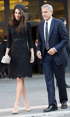 Amal looked chic in a black lace gown and nude heels.