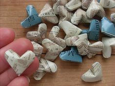 Origami hearts... Would be fun crafts with beautiful paper-- Valentines craft idea?