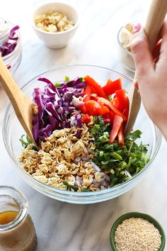 You're going to love this healthy Asian Kale Salad! It's made with delicious raw vegetables, a homemade Asian vinaigrette, and crunchy ramen for the perfect mixture of textures and flavor!