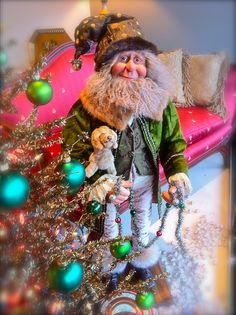 The incredible hand sculpted elves and Santas By Gail Lewis available at Red Living. www.redliving.ca