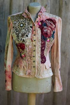 Whimsy hand dyed cotton velvet- the base is dyed in uneven shades of blush, wine, sand,cream.., richly reworked/embellished with intricate colorful details. The hems are adorned with antique and vintage textiles- printed appliques, vintage delicate golden lace,antique cream handmade lace trims, hand sculpted roses and silk rose petals. One hem is adorned with military accent- bullion fringes and silk/metal embroidered large applique, the other hem with beautiful vintage silk rose ap...