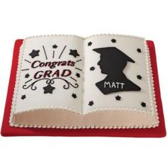 "This book shaped graduation cake looks good enough to read! With all the reading your graduate has done over the past 4 years, this personalized graduation cake is a perfect way to say ""a job well done."""
