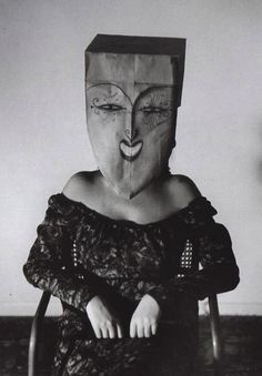 Saul Steinberg. I like how it is in black and white and also how you don't know what their expression is under the paper bags. This relates to my theme of disguise because they are disguising their emotions.