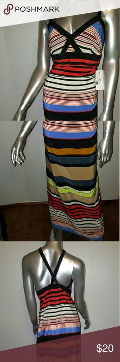 Nwt- JESSICA SIMPSON Maxi Multi Color Dress Sz L Stunning  Maxi dress by JESSICA SIMPSON Sz L/10  EXTREMELY Beautiful   Concealed back zip   Adjustable straps for custom fit-can be worn criss-cross or not  Perfect for beach party  or Saturday outings   Fabrication- 100%Polyester   Color- red, black,white, light blue&lime green   Feel free to contact me with any questions or concerns prior to purchase   Thank you for looking in my closet!  Kostkutter Jessica Simpson Dresses Maxi