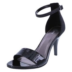 """Transform your dressy shoe collection with the Magik Sandal from Fioni. It features a wide strap across the vamp, glittery ankle cage with adjustable strap, 3 1/2"""" heel, and a rubber outsole. Manmade materials."""