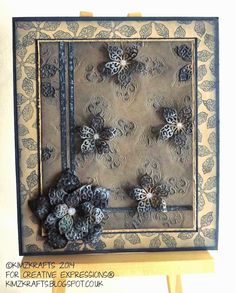 Creative Expressions Papercraft and Scrapbooking Products: Blue Sparkly Poinsettias by Kim Bacon