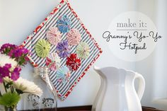 In the 1930s and 40s, it was popular to make entire quilts from a series of hand-sewn yo-yos. Those quilts are not only beautiful, but insanely huge accomplishments. Today, I'm pleased as pie...