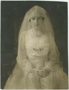 Helen Cray married Edsel Ford (son of the man who started the Ford car business) in 1916. Too bad this is a bad picture. Her dress is beautiful, it has a great deal of beading on the bodice.