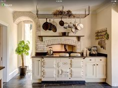 Beautiful AGA oven in rustic, country kitchen. Also has a little old world feel to it. The colors, the oven, the brick...beautiful.