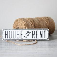 white enamel house for rent sign