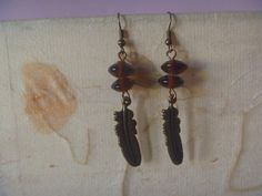 bronze and burgundy feather design earrings, handmade refashioned earrings Nickel Free Earrings, Second Hand Stores, Feather Design, Jewelry Supplies, Earrings Handmade, Burgundy, Bronze, Pendants, Etsy Shop