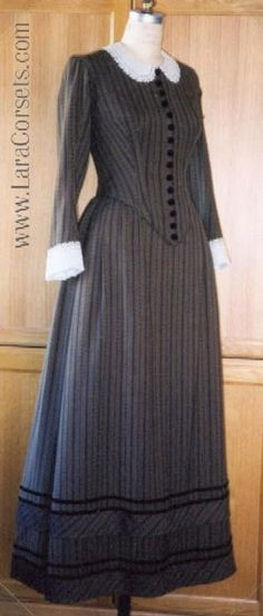 The victorian school teacher of striped wool with velvet banding and