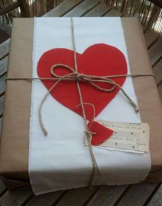 Red heart on brown paper