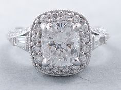 This is our marvelous ctw Cushion cut diamond ring in white gold we custom designed, ring style PFD# with a prong set ct F Clarity Enhanced Cushion cut center diamond x x mm) with ct in Baguettes and Round Cut accent diamonds that go halfway down the Cushion Cut Diamond Ring, Cushion Cut Diamonds, Beautiful Engagement Rings, Diamond Settings, Princess Cut Diamonds, Fashion Rings, Vintage Jewelry, White Gold, Wedding Rings