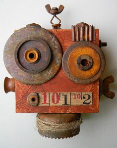 """Larry the robot."" (Just don't call him Rusty)  - Recycled art collage"