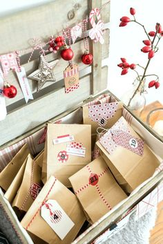 Homemade do it yourself advent calendar in a wooden box with paper bags and decoration by Tschibo in Diy Christmas Gifts For Family, Christmas Traditions, Xmas Gifts, Christmas Presents, Christmas Crafts, Christmas Decorations, Family Gifts, Christmas Ornaments, Christmas Sweaters