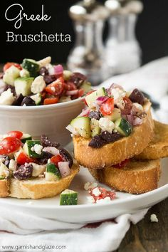 Olives, cucumbers, and feta give this delicious bruschetta recipe a Greek twist.