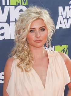 Alyson Michalkas Medium, Blonde, Curly, Half Updo is a Grecian take on a classic prom hairstyle. Steal her style: