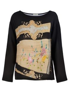 Black silk top from Dries Van Noten featuring a slash neck, contrast floral design to the front and rear and long sleeves.