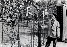 Elvis Presley at the gates of Graceland in 1957.