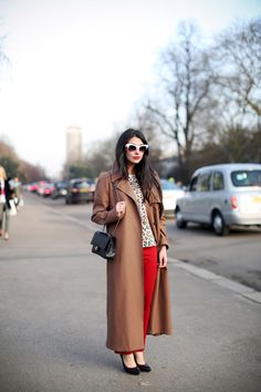 Leopard print sweater, hot red pants, cool white sunglasses, ankle length brown coat. Love it.