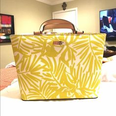 ☀️YELLOW KATE SPADE SMALL SUMMER HANDBAG☀️ Never used. Cheaper on Merc. Very cute for summer!! Superrrr light circle stain on front. Don't know where it came from. Shown in pic 4. kate spade Bags Totes