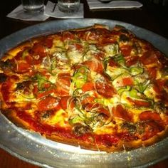 Louie's in Dallas. Total dive bar, but incredible thin crust pizza! (Diners Drive-Ins and Dives)