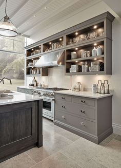 grey kitchen designs This modern grey kitchen is part of our new Butler collection. The kitchen features a smoked oak veneer island and top of the range appliances. Grey Shaker Kitchen, Modern Grey Kitchen, Grey Kitchen Designs, Industrial Style Kitchen, Luxury Kitchen Design, Grey Kitchens, Luxury Kitchens, Interior Design Kitchen, Cool Kitchens