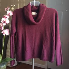 Knit Sweater Cowl neck sweater in burgundy. Really comfy. No rips or stains. There is one small loose thread shown in the photo above. Sweaters Cowl & Turtlenecks
