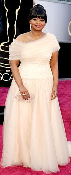 Octavia Spencer at the 2013 Oscars  The Help star donned her dress favorite designer, Tadashi Shoji. She completed her look with Prada heels, Lorraine Schwartz jewels and an Edie Parker clutch.