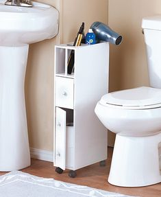 Slim Rolling Bathroom Storage Carts This Space-Saving Bathroom Organizer features a slender design that fits into small spaces. Built-in openings on top hold your hair dryer, curling iro Bath Storage, Small Bathroom Storage, Bathroom Organisation, Cabinet Storage, Storage For Small Spaces, Storage Cart, Small Bathroom Decorating, Bathroom Ideas, Storage Organizers