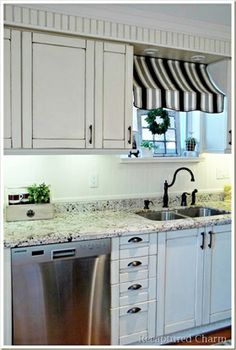 Love the canopy over the sink...it would be great for a window that needs shade in the hot months.