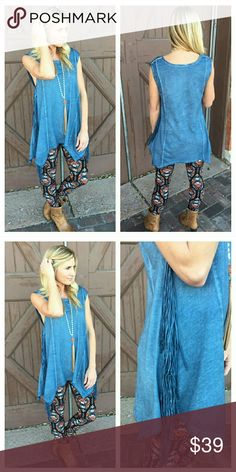 "NEW ARRIVAL 💓 Denim Blue Sleeveless Fringe Tunic Gorgeous and soft denim blue dye washed sleeveless tunic with fringe side details.    Pair with the Spring Paisley leggings pictured and available in a separate listing in my boutique, or wear with your favorite jeans.   65% Cotton 35% Polyester  Bust: S 18"" M 19"" L 20"" Length: S 28/33"" M 29/34"" L 30/35"" Infinity Raine Tops Tunics"