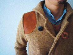tan coat, leather patches
