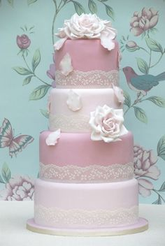A very romantic fairytale cake decorated with handmade dusky sugar roses and vintage lace.  Like the lace idea