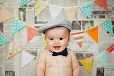 Six Month Portraits. Newspaper and bunting backdrop. Love.