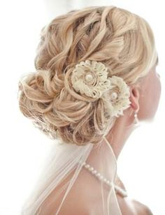 Floral Twisted Up do:  A simple teased up do with floral accessories. The touch of extravagance in this hairstyle is the twisting of the sections from the crown and then inserting and fixing them up to the bun. This can be great for an evening party also.