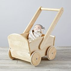 Taking your little doll for a walk is easier than ever with our Nod Doll Pram. It's made from solid wood and coordinates nicely with your little one's small-sized friends. Diy Dolls Pram, Dolls Prams, Doll Furniture, Kids Furniture, Baby Trolley, Accessoires Barbie, Little Girl Toys, Wooden Projects, Kids Wood