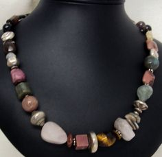 "22"" long necklace of an assortment of semi precious stones including; rose quartz, tiger eye, rhodonite, laboradorile, imperial jasper, tourmaline, smokey quartz, tourmaline crystals and beads. Silver beads from the Karen Hill Tribe in Thailand. See more at www.beadslouise.com"