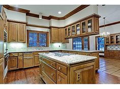this just isn't a kitchen worthy of a $2m+ home.  Architectural Gem offered for the first time. Custom designed, and built of the finest quality for the owner by Tony McClung. Beautiful woodwork,palladium windows,huge rooms,high ceilings,56 front porch(up and down),free form winding staircase,3 fireplaces,3-car garage with 2 room quarters above, large yard (from and rear), large closets. #zillow