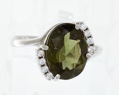 Stříbrný prsten s jihočeským broušeným vltavínem ve tvaru oválu se zirkony, které jsou po obou stranách šperku. Velikost vltavínu:  9×13 mm. Velikosti prstenů: 53, 55 , 56 Materiál: Stříbro 925/1000, rhodiovaný povrch zabraňující oxidaci a černání. Hmotnost šperku: 3,42 g Sunglasses, Shopping, Fashion, Moda, Fashion Styles, Sunnies, Shades, Fashion Illustrations, Eyeglasses