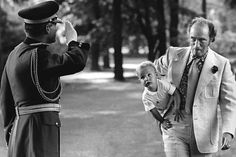 Canadian Prime Minister Pierre Elliott Trudeau carrying future Prime Minister Justin Trudeau under his arm in Ottawa, 1973