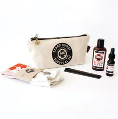 """Beard Buddy Survival Kit by Beard Buddy.   The """"Beard Buddy Survival Kit"""" is designed to help guide you on your beard journey and save it from being weird. Face farming is one thing, having it survive is another.  This unique grooming kit includes:  BEARD WASH  -A compact wash to clean out the weird  BEARD OIL  -A travel friendly oil to keep it soft, conditioned & smelling awesome  HANDKERCHIEF  -The perfect hanky for when things get messy  BARBERSHOP COMB  -A classic comb to keep your…"""