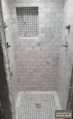 "Carrara Venato Dogbone Basketweave Mosaic $12.95SF and Venato 3x6"" Honed Subway Tile $7.00SF An almost completed Carrara Venato shower.  The Dogbone mosaic looks great and the 3x6"" is perfect.  Wha..."