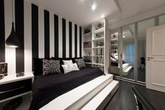 Love the striped wallpaper and design of this black and white bedroom.